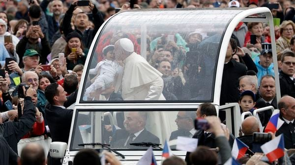 Pope Francis made a big change to the Popemobile when he decided to get rid of bulletproof screens. This enables him to add a more personal touch to his interactions as can be seen here. (AP Photo)