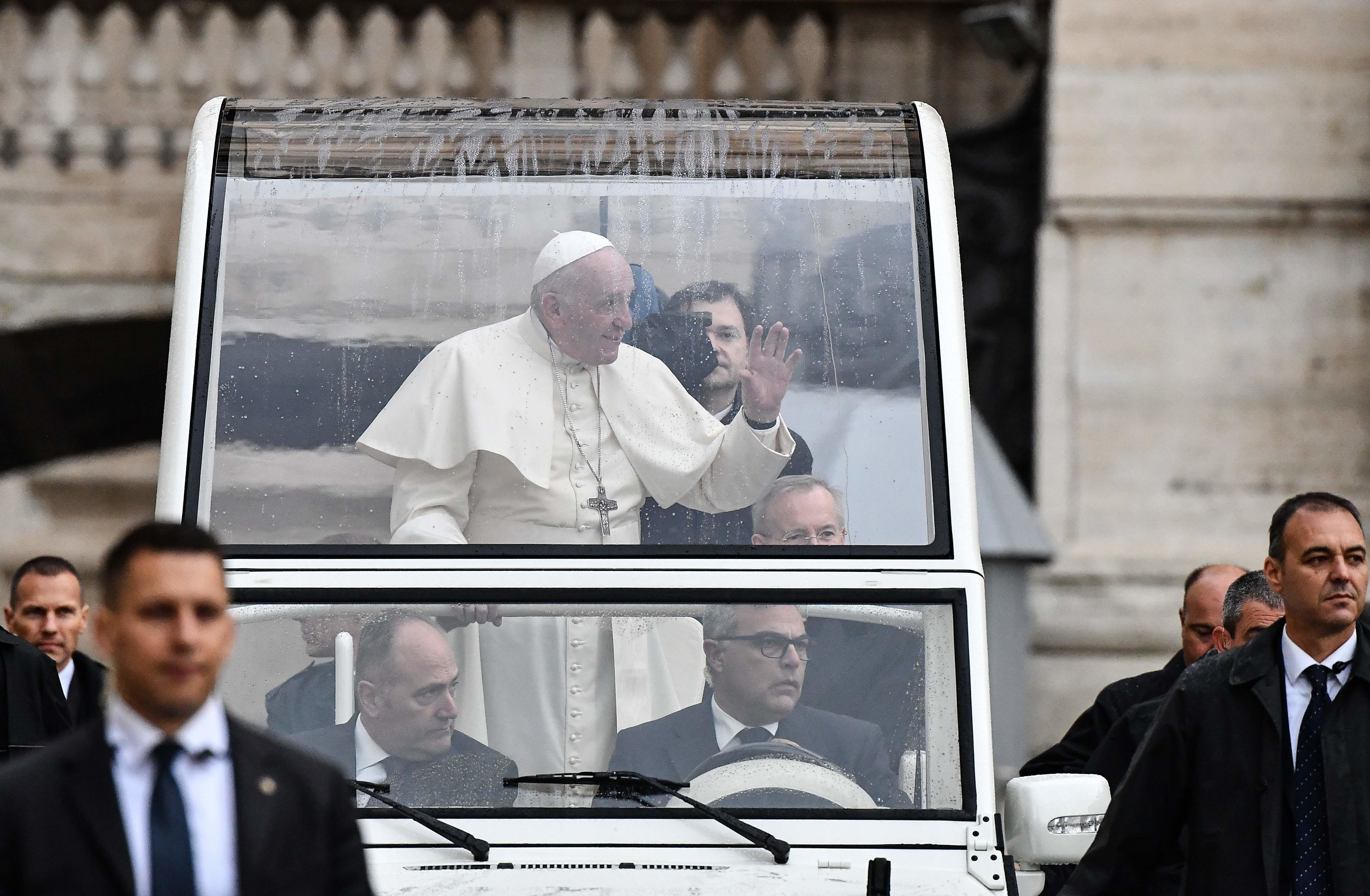 The Popemobile seen here has an overhead cover for protection from the rain but the sides are free from obstruction. Fiat usually supplies the popemobiles but cars from other manufactures too have often been used. (AFP Photo)