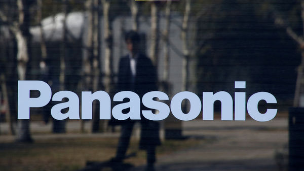 FILE PHOTO: A man is reflected on Panasonic Corp's logo at Panasonic Center in Tokyo (Reuters)