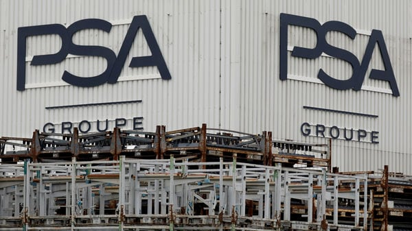The logo of PSA Peugeot Citroen is seen at the company's plant in Poissy, near Paris. (Reuters)