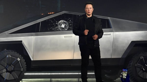 Tesla CEO Elon Musk unveils the Cybertruck at the TeslaDesign Studio in Hawthorne, Calif. The cracked window glass occurred during a demonstration on the strength of the glass. (Reuters)