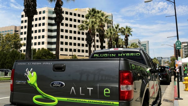 FILE PHOTO: A Ford ALTe hybrid electric F-150 pickup truck is shown outside the Electric Power Research Institute's Plug-In 2014 conference in San Jose, California (Reuters)