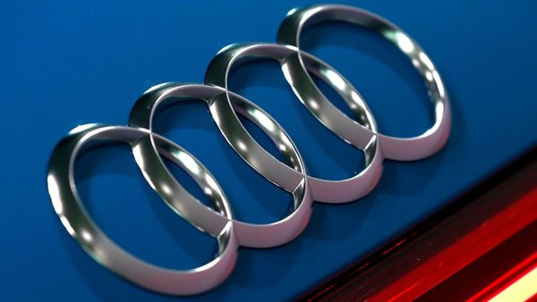 FILE - In this file photo dated Thursday, March 14, 2019, the logo of the German car manufacturer Audi is pictured on a Audi e-tron prior to the annual press conference in Ingolstadt, Germany. The Ingolstadt-based automaker said Tuesday Nov. 26, 2019, that it expected to add 2,000 new positions while Volkswagen subsidiary Audi says it is cutting 9,500 jobs in Germany through 2025. (AP Photo/Matthias Schrader, FILE) (AP)