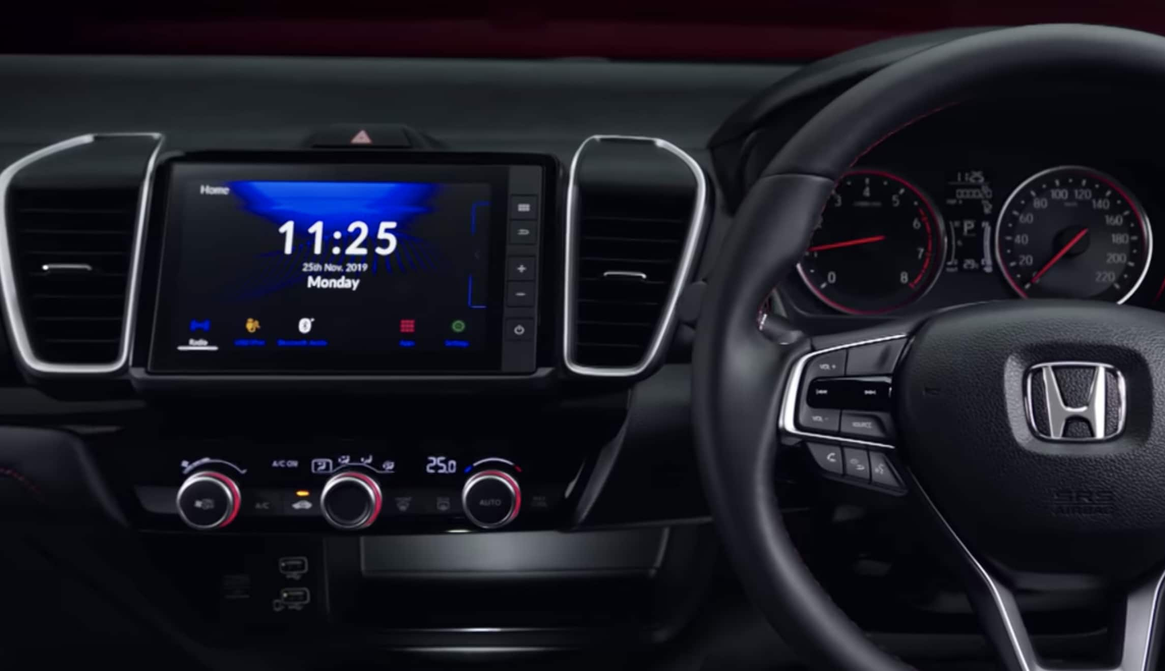 An 8-inch touchscreen is complimented by vertical air vents while there are two USB slots and a 12V power socket. Photo courtesy: Youtube/Honda Thailand