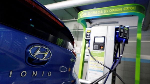FILE PHOTO: A Hyundai Motor's electric car IONIQ is charged at a electric charging station in Seoul