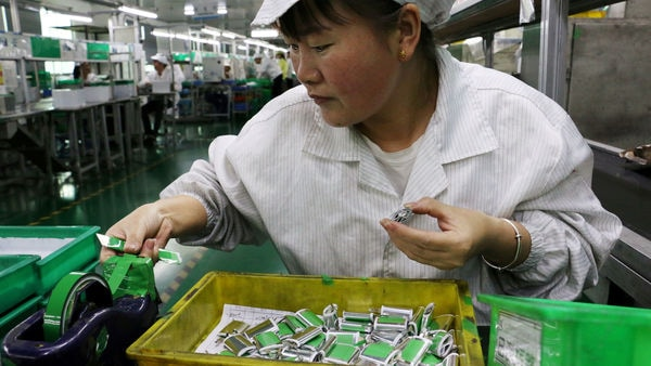 An employee works at a production line of lithium ion batteries inside a factory in China. (Reuters)