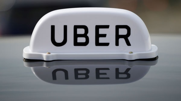 File photo: The Logo of taxi company Uber is seen on the roof of a private taxi.