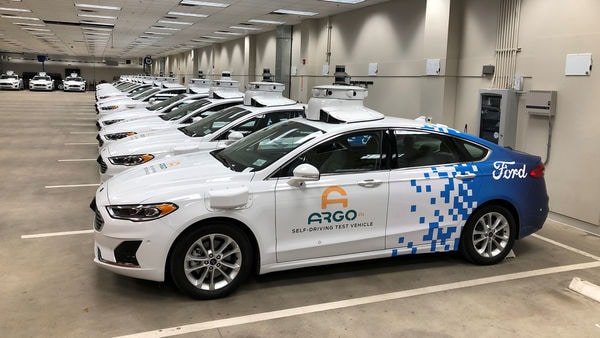 File photo: A row of Ford Fusion Hybrid sedans outfitted with sensors and other self-driving equipment in Argo's test garage. (REUTERS)