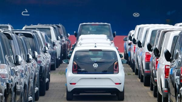 (FILES) This file photo taken on June 1, 2018 shows Volkswagen cars waiting to be shipped at the harbour in Bremerhaven, northern Germany. - Germany on November 14, 2019 dodged a technical recession with a slight third-quarter growth, leaving analysts divided over whether sunnier skies or further months flirting with a downturn lie ahead for Europe's biggest economy. (Photo by Patrik STOLLARZ / AFP) (AFP)