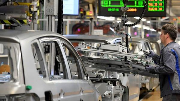 FILE PHOTO: An employee moves car components in a production line at the Volkswagen plant in Wolfsburg, Germany (Reuters)