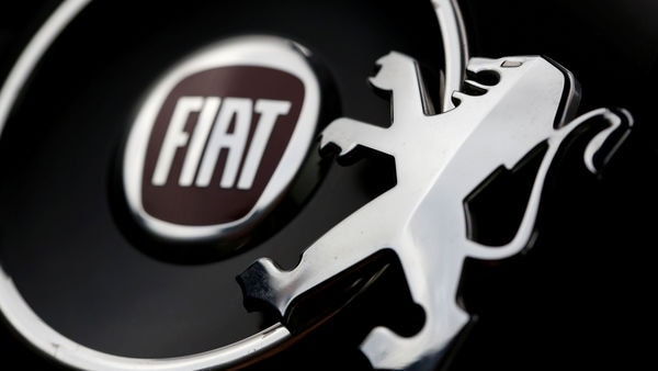 FILE PHOTO: Logos of Peugeot and Fiat