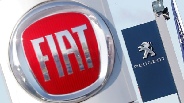 FILE PHOTO: The logos of car manufacturers Fiat and Peugeot