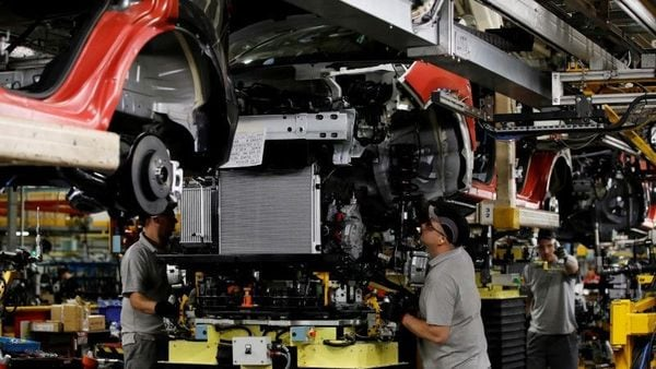 FILE PHOTO: Workers are seen on the production line at Nissan's car plant in Sunderland Britain, October 10, 2019. REUTERS/Phil Noble/File Photo