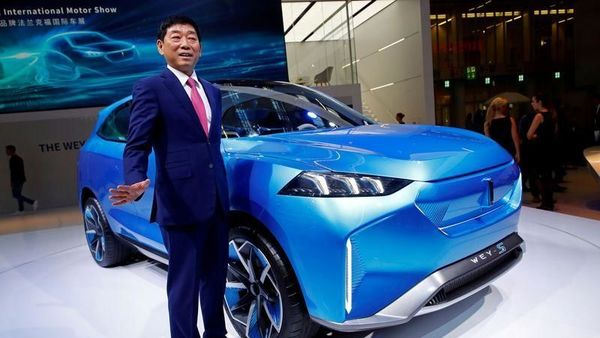 FILE PHOTO: Great Wall Motors CEO Wei Jianjun waves next to Wey S at the 2019 Frankfurt Motor Show (IAA) in Frankfurt, Germany. September 10, 2019. REUTERS/Wolfgang Rattay