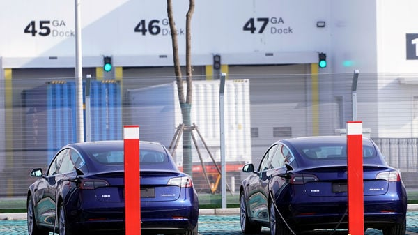 China-made Tesla Model 3 electric vehicles are seen at the Gigafactory of electric carmaker Tesla Inc in Shanghai, China December 2, 2019. REUTERS/Aly Song/Files