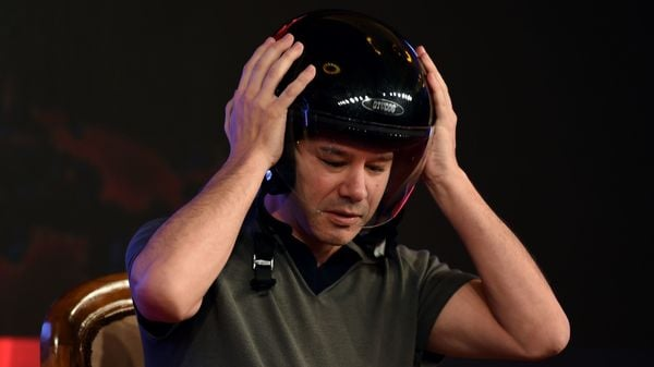(FILES) In this file photo taken on December 16, 2016 Co-founder and Chief Executive Officer (CEO) of US tranportation company Uber Travis Kalanick wears a helmet as he speaks at an event in New Delhi. - About a decade after co-founding Uber, Travis Kalanick on December 24, 2019, severed his last ties with the ride-hailing giant, announcing he would exit the board of directors at the end of 2019. Kalanick, who was pushed out as chief executive in 2017 amid revelations about the controversial business practices that accompanied the company's stunning rise, will resign from the board of directors effective December 31 'to focus on his new business and philanthropic endeavors,' Uber said in a statement. (Photo by MONEY SHARMA / AFP) (AFP)