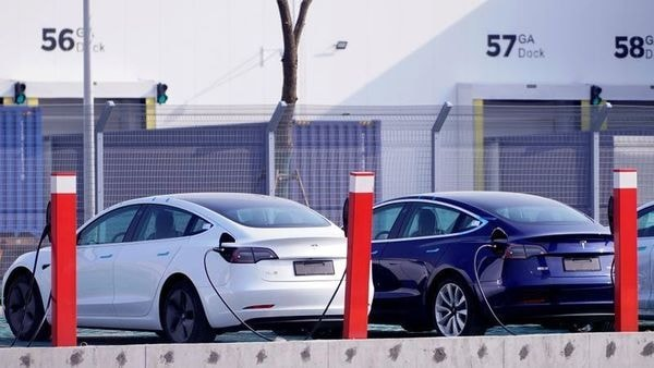 FILE PHOTO: China-made Tesla Model 3 electric vehicles are seen at the Gigafactory of electric car maker Tesla Inc in Shanghai, China December 2, 2019. REUTERS/Aly Song/File Photo (REUTERS)