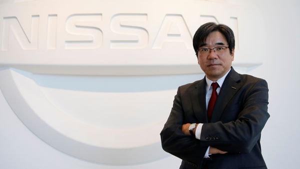 Nissan Executive Vice President Hideyuki Sakamoto poses with the carmaker's logo in the showroom at the carmaker's headquarters in Yokohama, Japan, January 13, 2017. REUTERS/Toru Hanai/Files