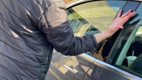 Photo of Ben Workman unlocking a Tesla car with his hands. (Photo courtesy: @wbkotv)