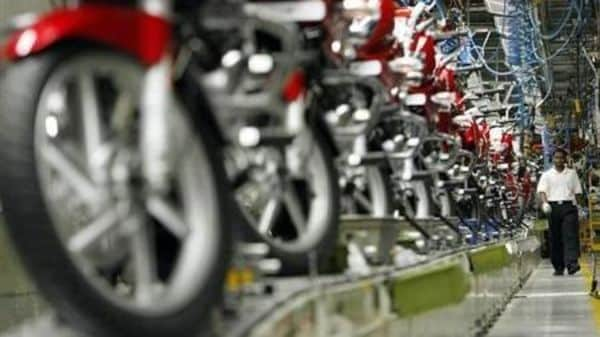 A worker walks beside newly built motorbikes at the Bajaj Auto Ltd. plant in Pune, about 130 km (82 miles) from Mumbai August 9, 2007. REUTERS/Punit Paranjpe/Files
