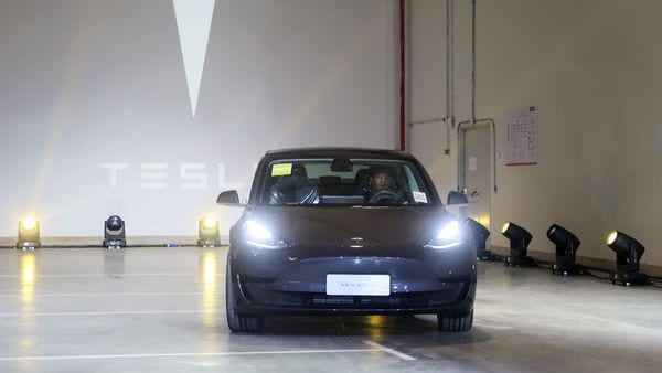 FILE PHOTO: A China-made Tesla Model 3 vehicle is seen at a delivery ceremony in the Shanghai Gigafactory of the U.S. electric car maker in Shanghai, China December 30, 2019. REUTERS/Yilei Sun/File Photo
