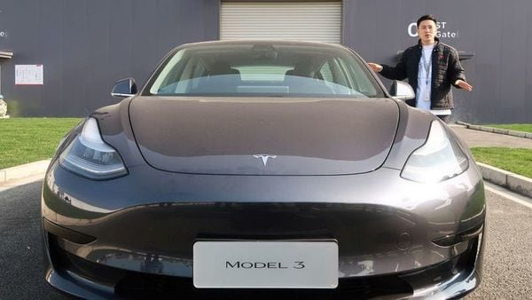 A staff member explains the China-made Tesla Model 3 vehicle at the Shanghai Gigafactory of the U.S. electric car maker in Shanghai. (REUTERS)