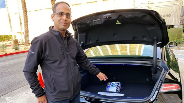 FILE PHOTO: Dheeraj Ahuja, Senior Director Of Engineering at Qualcomm, shows the new Snapdragon Ride autonomous driving computing system in the trunk of a demo car at the Consumer Electronics Show (CES) in Las Vegas, U.S., January 5, 2020. REUTERS/Jane Lanhee Lee