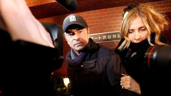 File photo of former Nissan Motor Chairman Carlos Ghosn accompanied by his wife Carole Ghosn. (REUTERS)