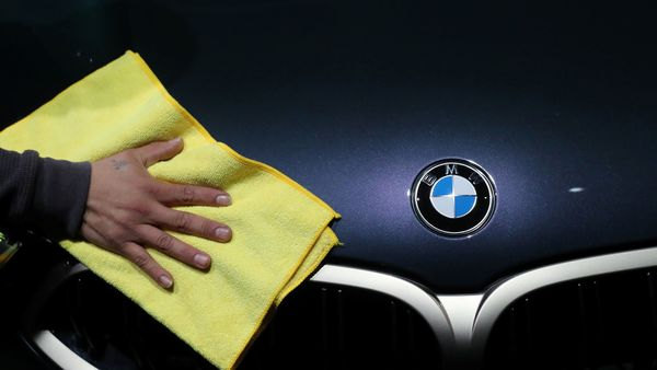 FILE PHOTO: A person wipes a BMW car. (Reuters)