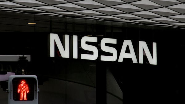 FILE PHOTO: The logo of Nissan Motor Co. is seen at its show room behind a traffic sign in Tokyo, Japan, February 12, 2019. REUTERS/Kim Kyung-hoon