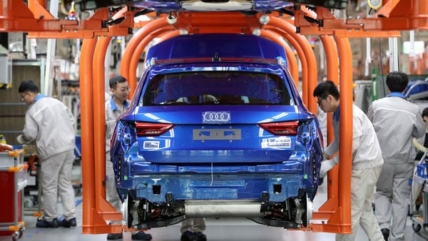 Workers work on an assembly line manufacturing Audi Q3 cars at the FAW-Volkswagen Tianjin plant in Tianjin, China December 5, 2019. Picture taken December 5, 2019. REUTERS/Stringer/Files