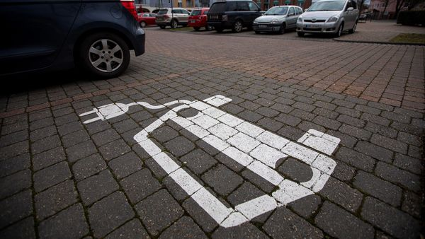 An empty electric vehicle charge point space sits in a parking lot in the market square in Gruenheide, Germany, on Monday, Jan. 13, 2020. Elon Musk is taking his fight for the future of transport into the heartland of the combustion engine, where the established players long laughed off Tesla as an upstart on feeble financial footing that couldn't compete with their rich engineering heritage. Photographer: Krisztian Bocsi/Bloomberg (Bloomberg)
