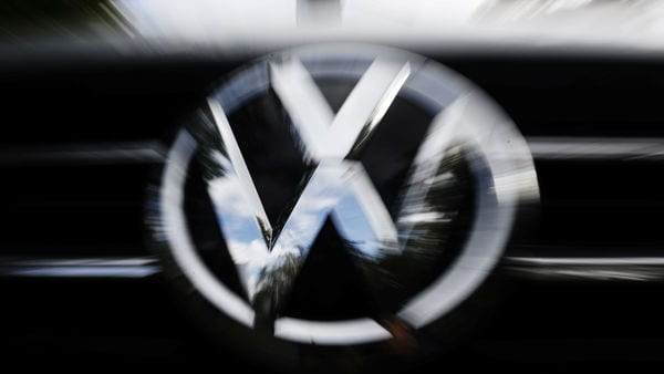 FILE PHOTO: The VW logo is seen at the site of the first hearing of a consumer group's class action suit on behalf of Volkswagen owners against VW over the diesel emissions cheating scandal, at the Higher Regional Court in Braunschweig, Germany, September 30, 2019. REUTERS/Michele Tantussi
