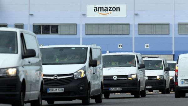 Delivery vehicles leaving an Amazon logistics centre.