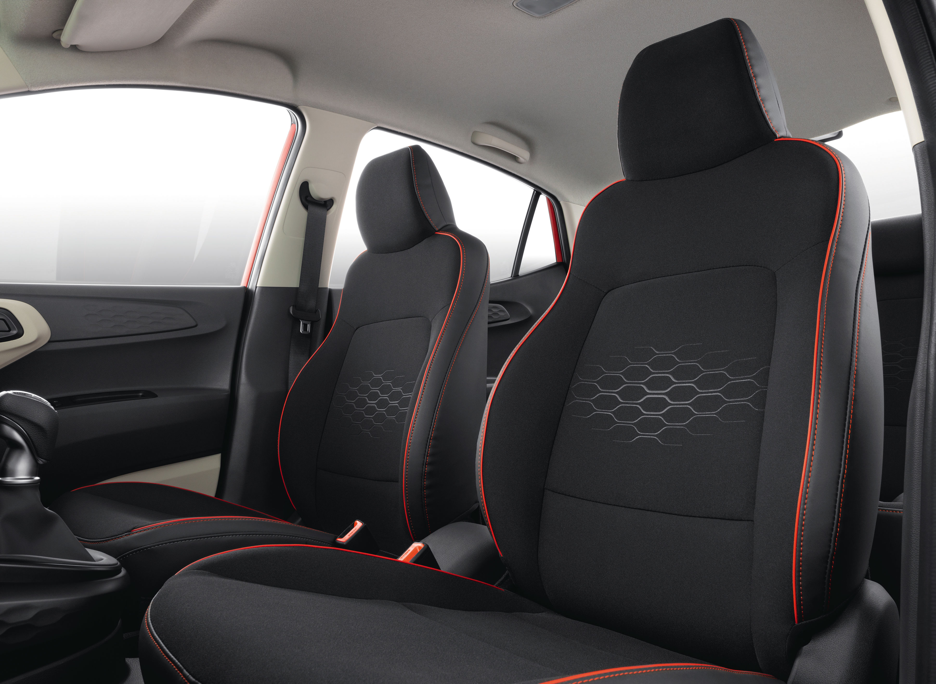 The turbo engine version gets sporty black colour hues on the inside while the other variants have a beige colour theme.