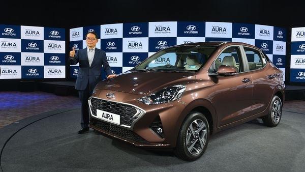 New Delhi: MD & CEO, Hundai Motors India, S S Kim, poses for photographs with the newly launched sedan Hyundai Aura, in New Delhi, Tuesday, Jan. 21,2020.(PTI Photo/Shahbaz Khan) (PTI1_21_2020_000044B) (PTI)