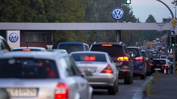 FILE PHOTO: Cars drive through the 'Sandkamp Gate' to the Volkswagen factory in Wolfsburg, Germany, September 23, 2015. REUTERS/Axel Schmidt/File Photo