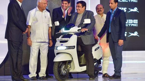 Bengaluru: Union Minister for Road Transport and Highway Nitin Gadkari with Karnataka Chief Minister B S Yeduyurappa (2nd L) and TVS Motor Company Chairman Venu Srinivasan (L) during the launch of the TVS iQube electric scooter in Bengaluru, Saturday, Jan. 25, 2020. (PTI Photo/Shailendra Bhojak) (PTI)