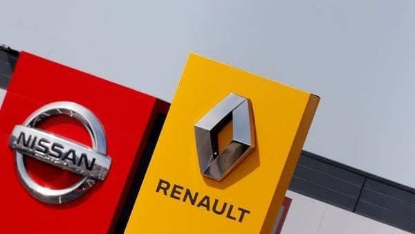 FILE PHOTO: The logos of car manufacturers Renault and Nissan are seen in front of dealerships of the companies in Reims, France. (REUTERS)