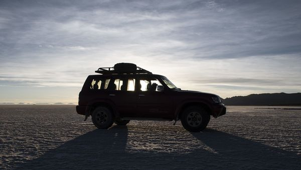 A sports utility vehicle (SUV) sits on the Salar de Uyuni (Uyuni Salt Flats) in Potosi, Bolivia, on Tuesday, Dec. 10, 2019. South America controls about 70% of the world's reserves of lithium, the metal used in rechargeable batteries for mobile phones and electric vehicles, with future refining and battery-assembling facilities seen as away to help kick start economies. Photographer: Carlos Becerra/Bloomberg (Bloomberg)