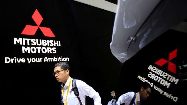 FILE PHOTO: A man walks near Mitsubishi cars as he visits Tokyo Motor Show in Tokyo. (REUTERS)