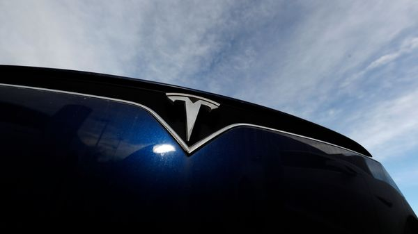 FILE - In this Nov. 10, 2019, file photo the company logo shines off the grille of an unsold 2020 Model X at a Tesla dealership in Littleton, Colo. Tesla reports financial results on Wednesday, Jan. 29, 2020. (AP Photo/David Zalubowski, File) (AP)