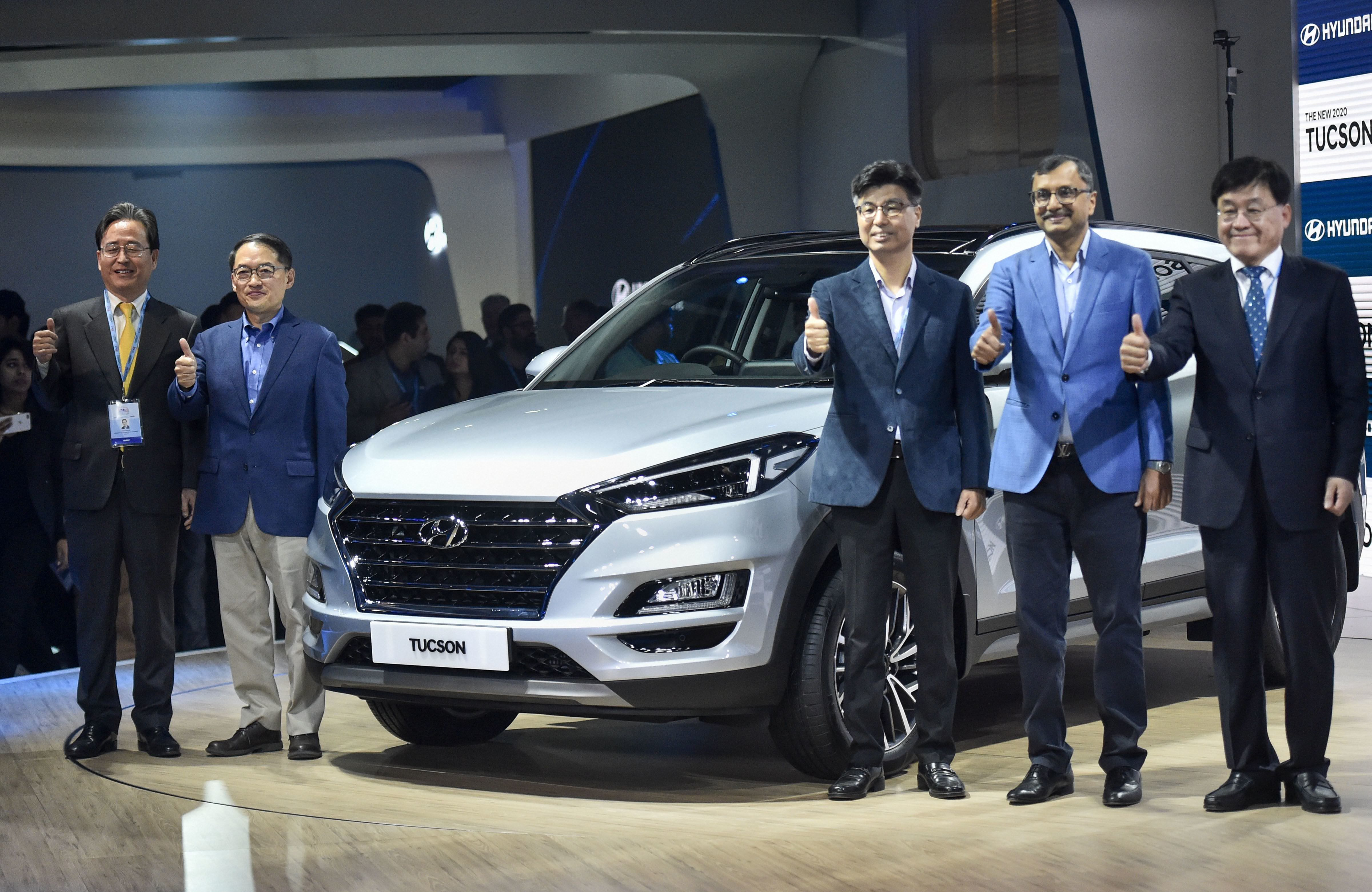 Managing Director and CEO of Hyundai Motors India Ltd, SS Kim (second from left) poses with other officials during the launch of the Hyundai Tucson at Auto Expo 2020 on Wednesday. The South Korean auto major has sold over 6.5 million units of Tucson in markets like the US, Europe, South Korea and China till date. (PTI)