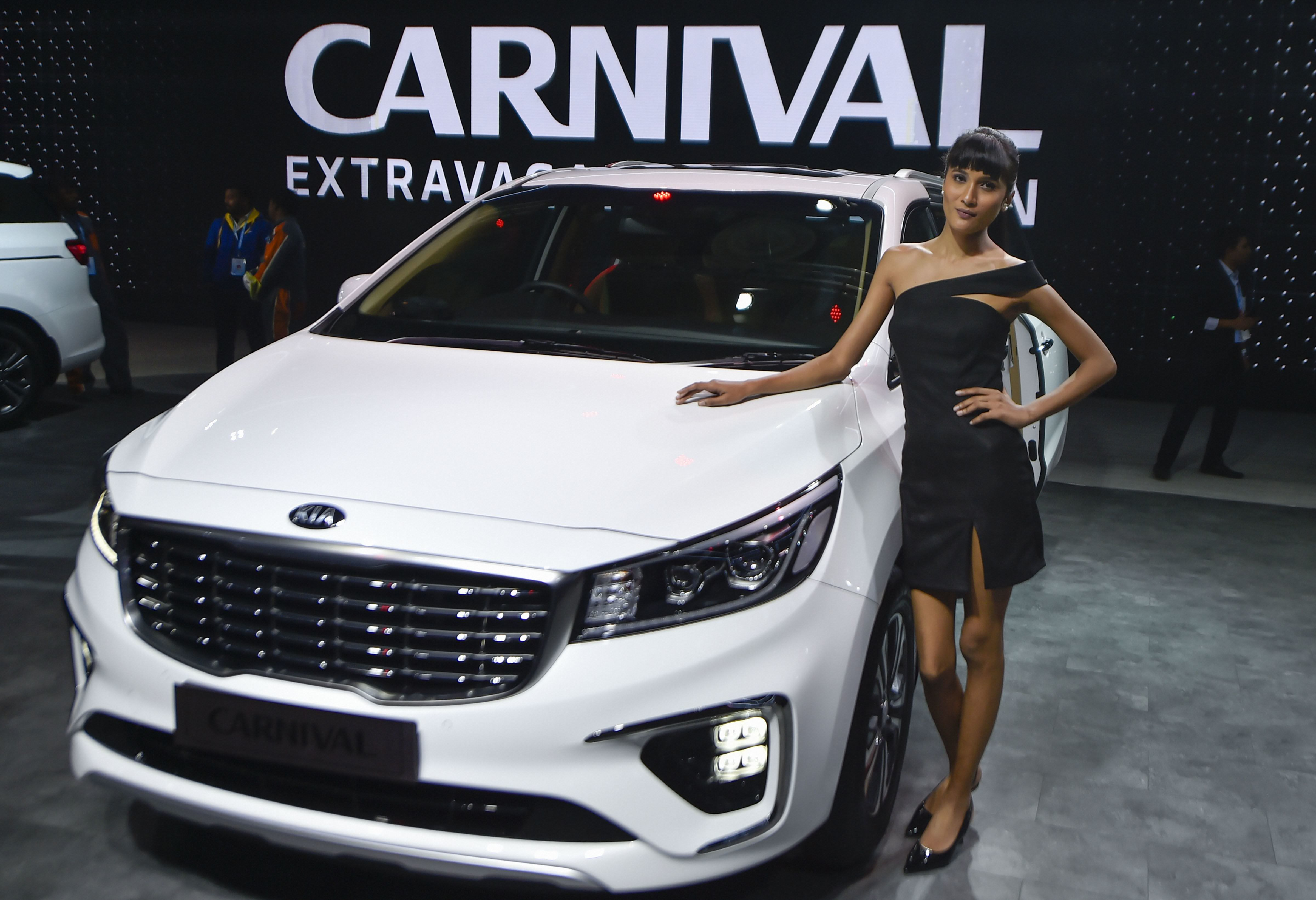 On the outside, Carnival has projector headlights and DRLs, Kia's signature Tiger-nose front grille and a tall profile. (PTI)