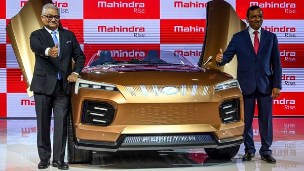 Managing Director (MD) of Mahindra and Mahindra Limited, Pawan Goenka (R), poses with the Mahindra Funster electric concept vehicle at the Auto Expo 2020. (AFP)