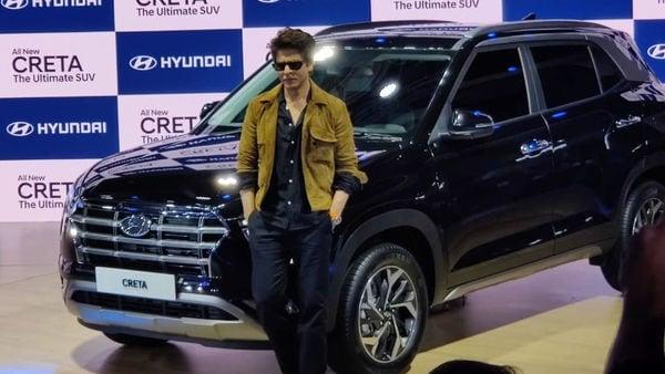 Shah Rukh Khan poses with the new Creta from Hyundai at Auto Expo 2020.