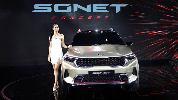 A model poses next to KIA Sonet car at the Auto Expo in Greater Noida, near New Delhi. (AP)
