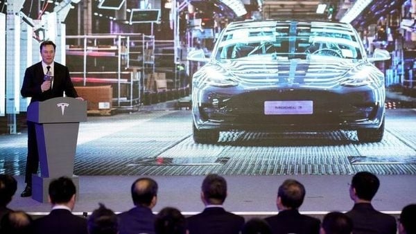 FILE PHOTO: Tesla Inc CEO Elon Musk speaks next to a screen showing an image of Tesla Model 3 car during an opening ceremony for Tesla China-made Model Y program in Shanghai, China January 7, 2020. REUTERS/Aly Song (REUTERS)