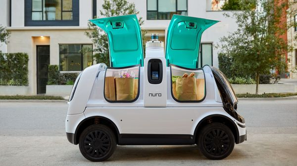 Nuro R2, a self-driving delivery vehicle, is shown with compartments ready for unloading in an undated photo in Houston, Texas, U.S. Nuro Inc/Handout via REUTERS. (via REUTERS)