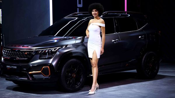 A model stands next to a Seltos X-Line concept launched by KIA Motors at the Auto Expo 2020 in Greater Noida on Thursday. (ANI)